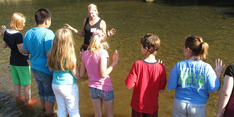 Kids learning in a river